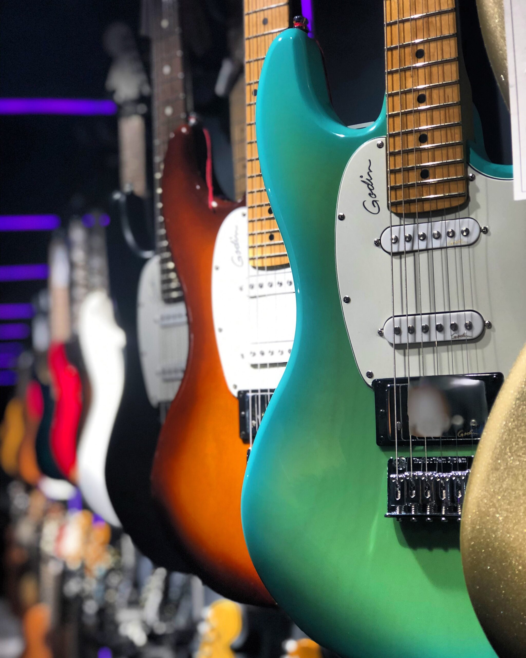 Row of electric guitars in shop by Mohrez Labaf